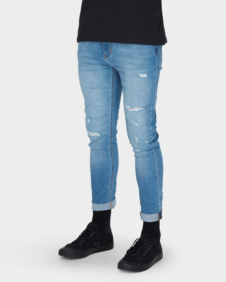 A DROPPED SKINNY TURN UP JEAN